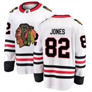 Fanatics Branded Chicago Blackhawks 82 Caleb Jones White Breakaway Away Youth NHL Jersey